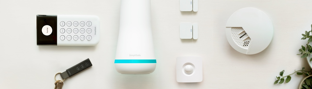 SimpliSafe system containing key fob, keypad, base station, motion sensor, two entry sensors and a smoke detector