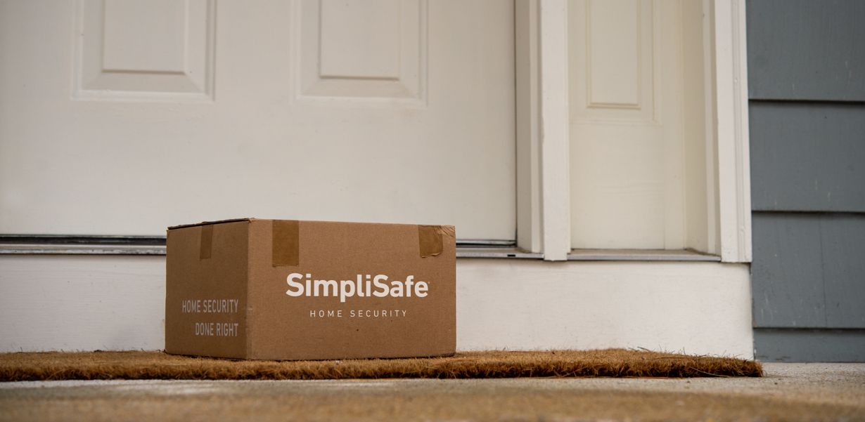 Image of a SimpliSafe package on a doorstep.
